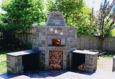 Overview of wood fired oven with fire